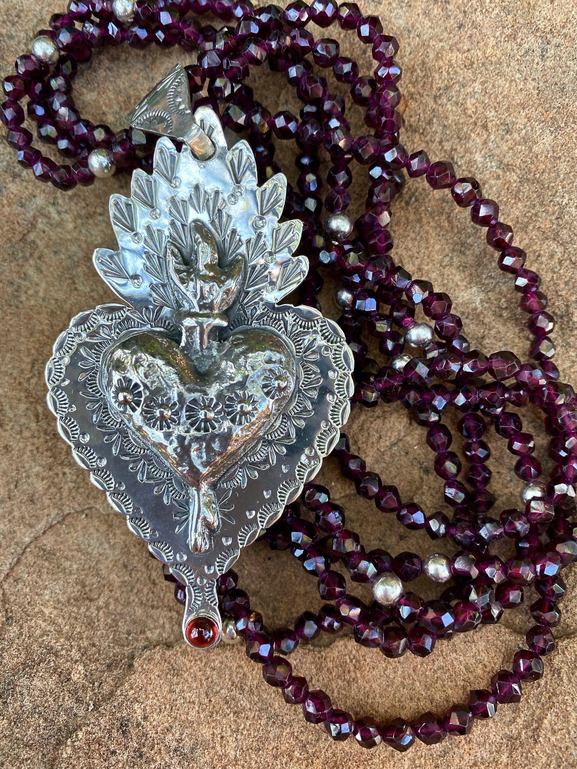 """Sterling Silver and Garnet Sacred Heart"" by Bernadette Marquez"